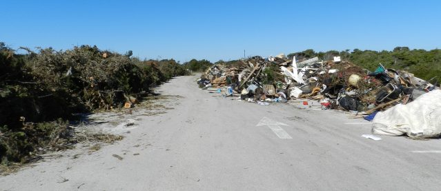 The Temporary Debris Storage Site of debris from Hurricane Matthew on Ocracoke is in the lifeguard beach parking lot. Photo: C. Leinbach