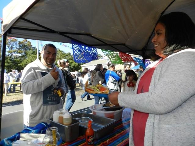 "Edith ""Chelly"" Trejo, right, serves chicharrones, a kind of Mexican salad."