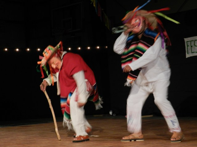 "Eduardo Chavez, left, owner of Eduardos Taco Stand, dances ""The Dance of the Elders"" with a member of the Ballet Foklorico."