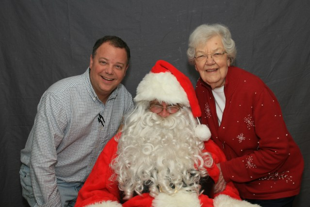 Tommy Hutherson, left, and his mother Julia, owner of the Ocracoke Variety Store, sponsor a visit by Santa Claus every year. Photo: Trudy Austin