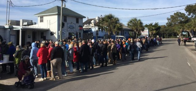 The long line for the 12th Annual Oyster Roast on Saturday at the Ocracoke Seafood Co. aka, the Fish House, Ocracoke, NC. Photo: C. Leinbach