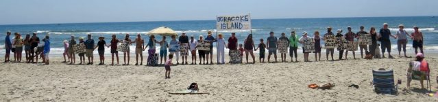 Hands Across Sand at Ocracoke's Lifeguard Beach, 2017. This year's event will be noon on Saturday (May 19). Photo: P. Vankevich