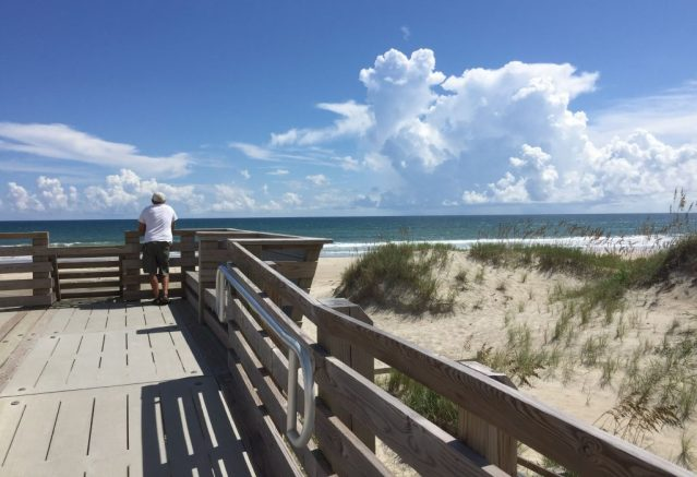 An islander gazes at the calm surf Tuesday afternoon ahead of Hurricane Florence at the Lifeguard beach at Ocracoke, N.C. Photo: C. Leinbach