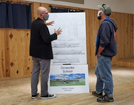 Architect Ben Cahoon briefs high school English teacher Charles Temple on the design for the new Ocracoke NC school.  Photo by Richard Taylor