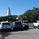 Visitors-cars-and-golf-carts-fill-Ocracoke-Light-Station-parking-lot-Friday-afternoon-June-18-2021