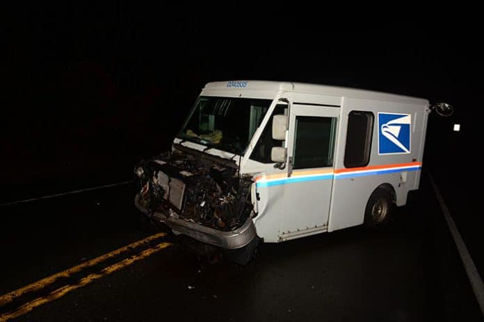 MANCHESTER: USPS Truck Collides with pick-up truck