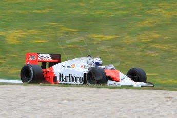 World © Octane Photographic Ltd. Sunday 21st June 2015. F1 Legends Parade – Red Bull Ring, Spielberg, Austria. 1985 Marlboro McLaren MP4-2B - Alain Prost. Digital Ref. : 1321CB7D7496
