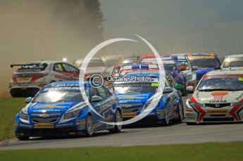 © Octane Photographic Ltd. 2011. British Touring Car Championship – Snetterton 300, Jason Plato - Chevrolet Cruze - leads the field though the flying dust of a spinning Matt Neal. Sunday 7th August 2011. Digital Ref : 0124CB1D4166