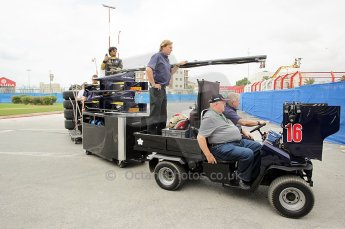 © Octane Photographic Ltd. 2011. European Formula1 GP, Friday 24th June 2011. GP2 Practice. Fairuz Fauzy hitches a lift on the Super Nova Racing mobile garage. Digital Ref: 0082CB1D6176