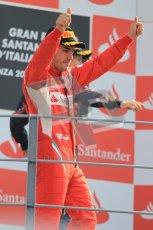 © Octane Photographic Ltd. 2011. Formula 1 World Championship – Italy – Monza – 11th September 2011 – Podium – Fernando Alonso (Ferrari) salutes teh loyal Tifossi. Digital Ref : 0178CB1D4134