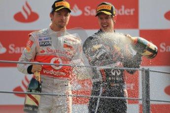 © Octane Photographic Ltd. 2011. Formula 1 World Championship – Italy – Monza – 11th September 2011 – Podium – Jenson Button (McLaren) watches Sebastian Vettel spray Champagne into the pitlane. Digital Ref : 0178CB1D4246