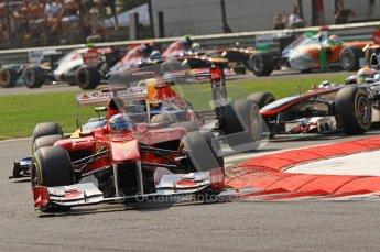 © Octane Photographic Ltd. 2011. Formula 1 World Championship – Italy – Monza – 11th September 2011 Fernando Alonso (Ferrari) and Sebastian Vettel (Red Bull) lead the pack on lap 1 – Race – Digital Ref : 0177CB7D7842