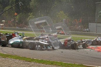 © Octane Photographic Ltd. 2011. Formula 1 World Championship – Italy – Monza – 11th September 2011 – Race –  Debris showers the track after the accident caused by Viantonio Liutzi (HRT) takes out Nico rosberg (Mercedes) and Vitaly Petrov (Renault) – Digital Ref :  0177CB7D7871