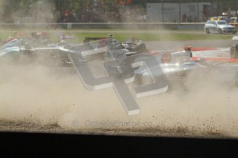 © Octane Photographic Ltd. 2011. Formula 1 World Championship – Italy – Monza – 11th September 2011 Dust flys as the pack avoids the 1st corner accident – Race – Digital Ref : 0177CB7D7880