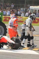 © Octane Photographic Ltd. 2011. Formula 1 World Championship – Italy – Monza – 11th September 2011 Viantonio Liutzi is lead away from his wrecked HRT after causing the huge 1st corner accident – Race – Digital Ref : 0177CB7D7888