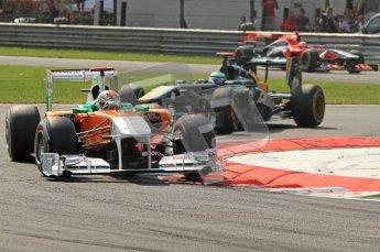 © Octane Photographic Ltd. 2011. Formula 1 World Championship – Italy – Monza – 11th September 2011 Adrian Sutil (Force India) and Heikki Kovalainen (Team Lotus) – Race – Digital Ref : 0177CB7D8067