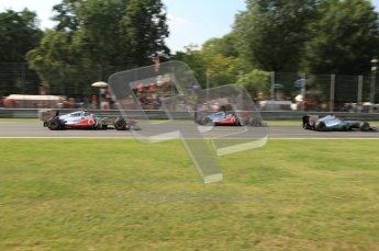 © Octane Photographic Ltd. 2011. Formula 1 World Championship – Italy – Monza – 11th September 2011 – Race – The brakes of Lewis Hamilton glow as he as fellow McLaren team mate Jenson Button queue behind a difficult Michael Schumacher in his Mercedes. Digital Ref : 0177CB7D8150