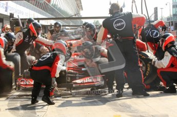 © Octane Photographic Ltd. 2011. Formula 1 World Championship – Italy – Monza – 11th September 2011 Mid-tyre change for Virgin Racing as Timo Glock makes his final pitstop – Race – Digital Ref : 0177CB7D8217
