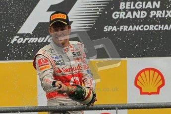 © Octane Photographic Ltd. 2011. Formula One Belgian GP – Spa – Sunday 28th August 2011 – Jenson Button celebrating on the podium. Digital Reference : 0169cb1d1130