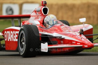 © Octane Photographic 2011. Dan Wheldon Taking a Chip Ganissi car up the hill. Goodwood Festival of Speed, Thursday 30th June 2011. Digital Ref : 0097CB7D676