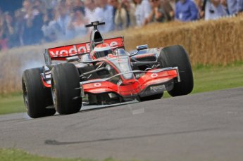 © Octane Photographic 2011. Goodwood Festival of Speed, Friday 1st July 2011. McLaren MP4/24 driven by Chris Goodwin. Digital Ref : 0097CB7D6967