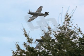 © Octane Photographic 2011 – Goodwood Revival 17th September 2011. Spitfires through the trees. Digital Ref : 0179CB1D4423