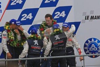 © Octane Photographic 2011. Le Mans finish line and podium - Sunday 11th June 2011. La Sarthe, France. Digital Ref : 0263lw7d8178