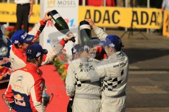 © North One Sport Ltd.2011/Octane Photographic Ltd. WRC Germany – Final Podium - Sunday 21st August 2011. Carlos Corral gets a bottle of champaign down the back of his neck from Daniel Sordo. Digital Ref : 0153CB1D6504