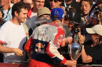 © North One Sport Ltd.2011/Octane Photographic Ltd. WRC Germany – Final Podium - Sunday 21st August 2011. Sebastien Ogier receiving a big kiss from a fan. Digital Ref : 0153CB1D6515