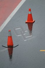 World © Octane Photographic 2011. Formula 1 testing Saturday 12th March 2011 Circuit de Catalunya. McLaren pitlane in the wet. Digital ref : 0018CB1D4372