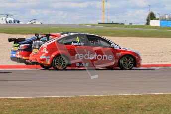 © Octane Photographic Ltd. BTCC - Round Two - Donington Park - Race 1. Sunday 15th April 2012. Jason Plato runs wide over the Esses chicane under pressure from Mat Jackson. Digital ref : 0295lw7d3572