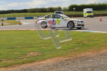 © Octane Photographic Ltd. BTCC - Round Two - Donington Park - Race 1. Sunday 15th April 2012. Nick Foster pushing hard on 2 wheels through the Esses in his eBay Motors BMW 320si. Digital ref : 0295lw7d3748