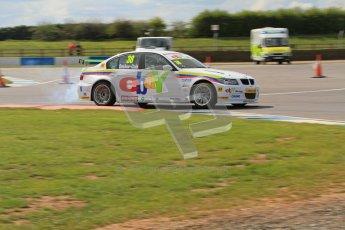 © Octane Photographic Ltd. BTCC - Round Two - Donington Park - Race 1. Sunday 15th April 2012. Tom Onslow-Cole smoking. Digital ref : 0295lw7d3881