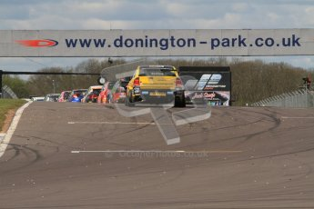 © Octane Photographic Ltd. BTCC - Round Two - Donington Park - Race 1. Sunday 15th April 2012. Race over and teh cars peel into the pitlane through the on track post-race dirt and debris. Digital ref : 0295lw7d4094