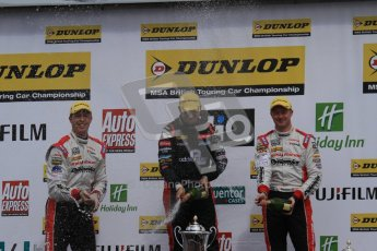 © Octane Photographic Ltd. BTCC - Round Two - Donington Park - Race 1. Sunday 15th April 2012. Mat Jackson, Matt Neal and Gordon Shedden spray the podium champagne. Digital ref : 0295lw7d4236