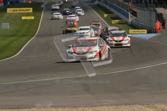 © Octane Photographic Ltd. BTCC - Round Two - Donington Park - Race 2. Sunday 15th April 2012. The grid warm their tyres on the formation lap for race 2. Digital ref : 0296lw7d4303