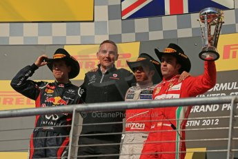 World © Octane Photographic Ltd. Formula 1 USA, Circuit of the Americas - Podium - Lewis Hamilton and Martin Whitmarsh (McLaren), Sebastian Vettel (Red Bull) and Fernando Alonso (Ferrari) on the podium. 18th November 2012 Digital Ref: 0561lw1d4999