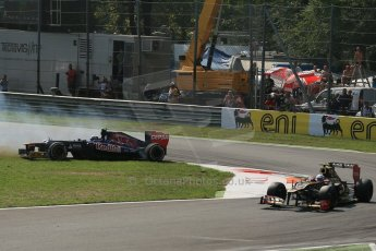 World © Octane Photographic Ltd. Formula 1 Italian GP, 9th September 2012. Jean-Eric Vergne on teh grass after a suspension failure - heading for big air in his Toro Rosso STR7. Digital Ref : 0518lw1d9517