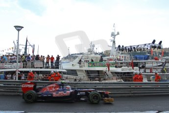 © Octane Photographic Ltd. 2012. F1 Monte Carlo - Practice 2. Thursday 24th May 2012. Jean Eric vergne - Toro Rosso powers past the moored yachts in the harbour. Digital Ref : 0352cb7d8226