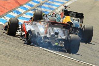 © 2012 Octane Photographic Ltd. German GP Hockenheim - Sunday 22nd July 2012 - F1 Race. McLaren MP4/27 - Lewis Hamilton with a shredded rear left is passed by the Caterham of Heikki Kovalainen. Digital Ref : 0423lw1d4971