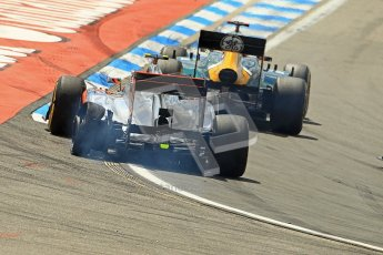 © 2012 Octane Photographic Ltd. German GP Hockenheim - Sunday 22nd July 2012 - F1 Race. McLaren MP4/27 - Lewis Hamilton with a shredded rear left is passed by the Caterham of Heikki Kovalainen. Digital Ref : 0423lw1d4974