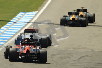 © 2012 Octane Photographic Ltd. German GP Hockenheim - Sunday 22nd July 2012 - F1 Race. McLaren MP4/27 - Lewis Hamilton with a shredded rear left is passed by the Caterhams of Heikki Kovalainen and Vitaly Petrov as Charles Pic lines up his move as well. Digital Ref : 0423lw1d4979