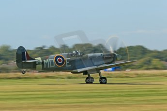 World © 2012 Octane Photographic Ltd. Goodwood Revival. September 15th 2012. Spitfire landing. Digital Ref : 0521cb1d9508