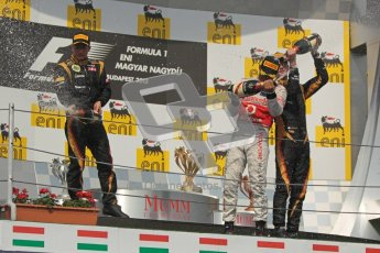 © 2012 Octane Photographic Ltd. Hungarian GP Hungaroring - Sunday 29th July 2012 - F1 Podium. Lewis Hamilton - Race winner, Kimi Raikkonen, 2nd and Romain Grosjean, 3rd, spray the champaign. Digital Ref :