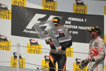 © 2012 Octane Photographic Ltd. Hungarian GP Hungaroring - Sunday 29th July 2012 - F1 Podium. Lewis Hamilton - Race winner, and Kimi Raikkonen, 2nd, spray the champaign. Digital Ref :