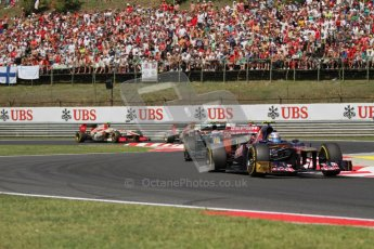 © 2012 Octane Photographic Ltd. Hungarian GP Hungaroring - Sunday 29th July 2012 - F1 Race. Toro Rosso STR7 - Daniel Ricciardo and Caterham CT01 - Heikki Kovalainen. Digital Ref :