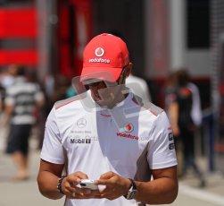 © 2012 Octane Photographic Ltd. Hungarian GP Hungaroring - Sunday 29th July 2012 - F1 Paddock. McLaren - Lewis Hamilton tweeting. Digital Ref : 0437lw7d8307