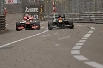 © Octane Photographic Ltd. 2012. F1 Monte Carlo - Race. Sunday 27th May 2012. Jenson Button - McLaren and Heikki Kovalainen - Caterham, going wheel to wheel up Casino Hill. Digital Ref : 0357cb7d0326
