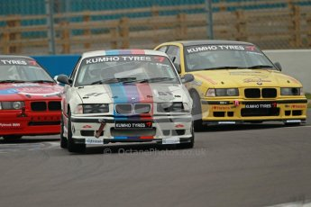 © Octane Photographic Ltd. Motors TV day – Donington Park,  Saturday 31st March 2012. Kumho BMW Championship, Stuart Laws - BMW E36 M3 and James Cannon - BMW Compact. Digital ref : 0266cb1d9386