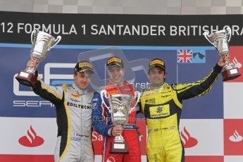 © 2012 Octane Photographic Ltd. British GP Silverstone - Sunday 8th July 2012 - GP2 Race 2 - Davide Valsecchi, Luiz Razia and Felipe Nasr rais their trophies on the podium. Digital Ref : 0401lw7d7688